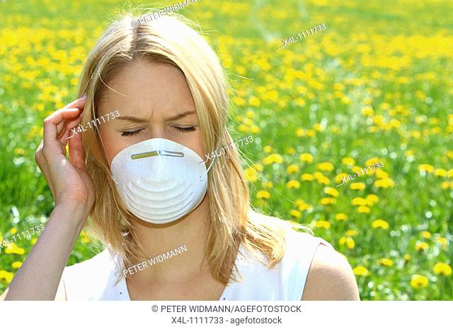 Women with pollen allergy in a Spring Meadow