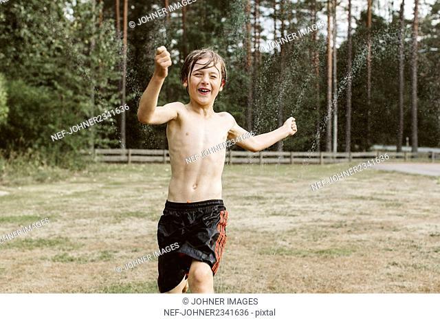 Happy boy playing in backyard