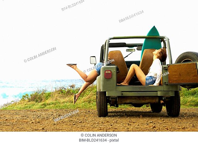 Women laughing in off-road vehicle