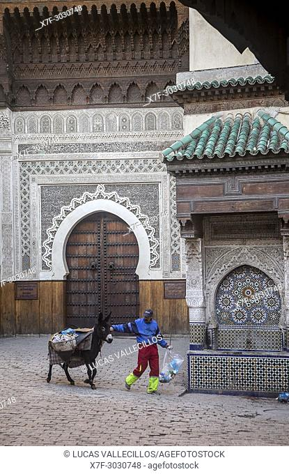 Place an-Nejjarine. In background, the brown door is the Art and wood crafts Museum . Fez. Morocco