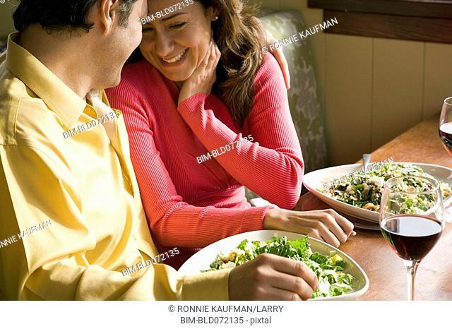 Hispanic couple having romantic dinner