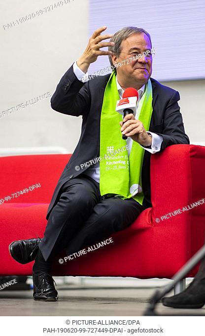 20 June 2019, North Rhine-Westphalia, Dortmund: Armin Laschet (CDU) (l), Minister President of North Rhine-Westphalia, takes part in a discussion round of the...