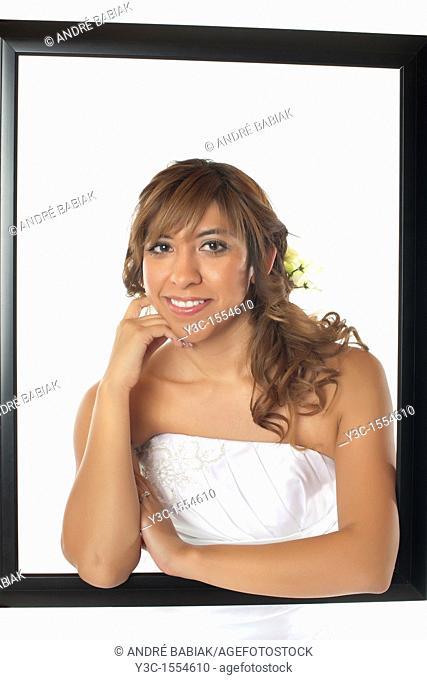 Hispanic bride with bridal flower bouquet