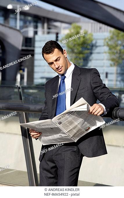 A businessman reading the paper on the airport, Denmark