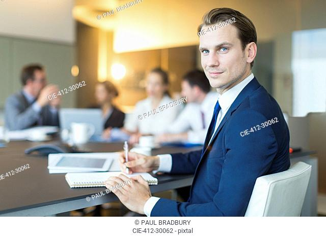 Portrait confident businessman in conference room meeting