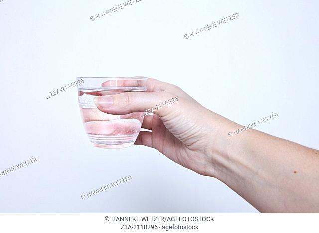 Hand Holding Glass Of Water, Hand Gesture, Studio shot
