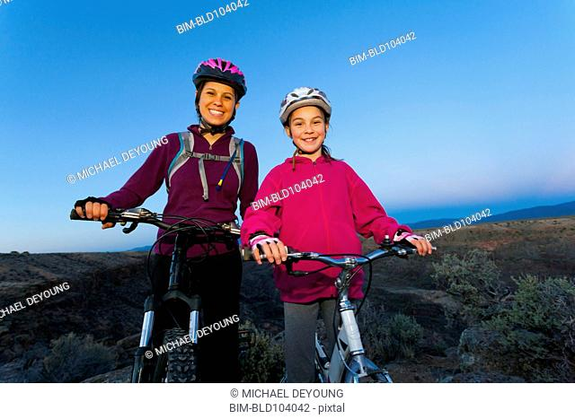 Sisters mountain biking together