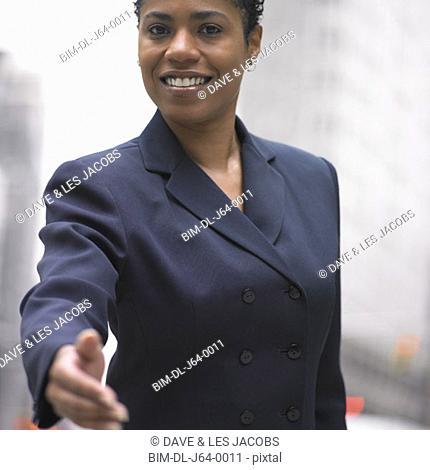 Businesswoman extending hand