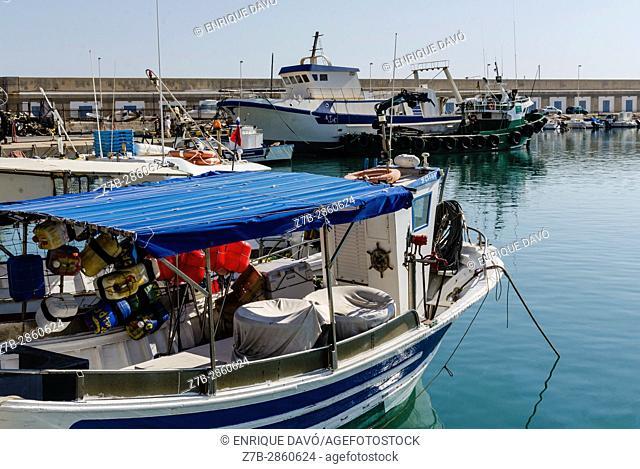 A blue boat view in Carboneras port, Almería, Spain
