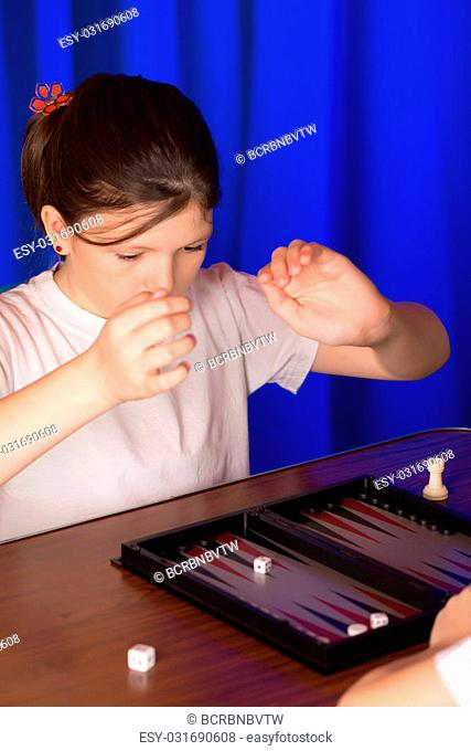girl playing ancient Eastern game called Backgammon