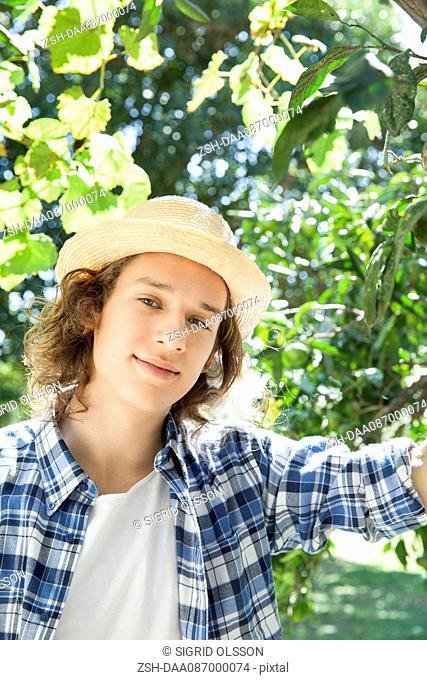 Young man wearing sun hat, portrait