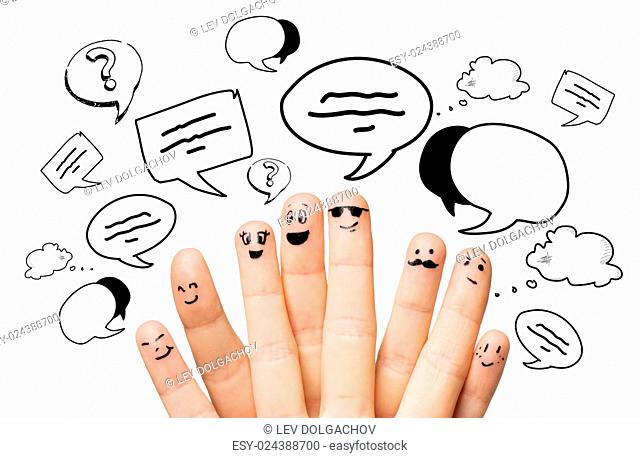 communication, family, people and body parts concept - close up of two hands showing fingers with different facial expressions and text clouds