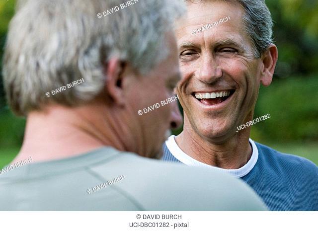 Men laughing outdoors