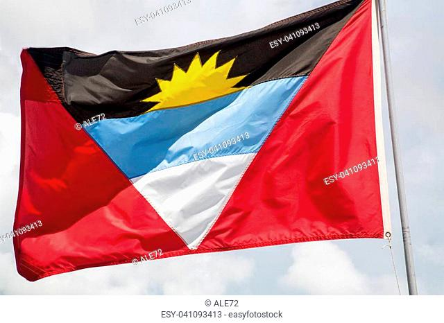 Antigua, the flag of Antigua and Barbuda waving on the wind
