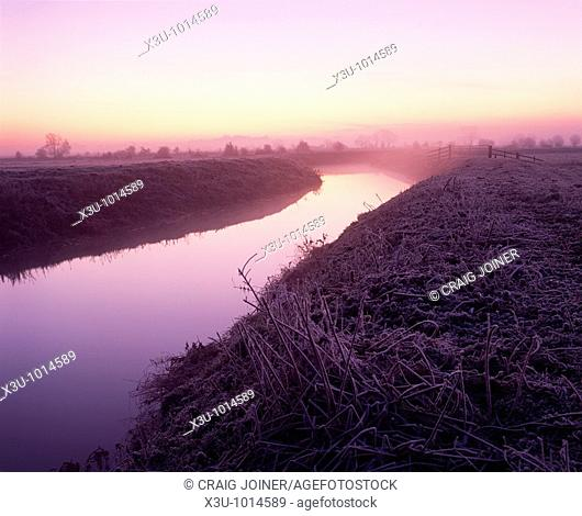 The River Brue at dawn on South Moor on the Somerset Levels at Glastonbury, Somerset, England, United Kingdom