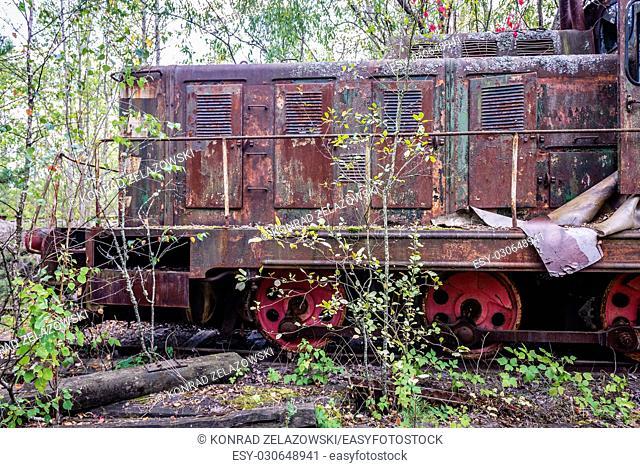 Old Soviet engine near Prypiat city and Yaniv railway station in Chernobyl Nuclear Power Plant Zone of Alienation in Ukraine