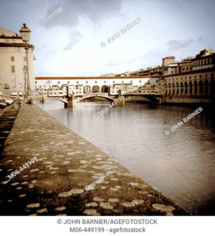 A view of the Ponte Vecchio Bridge over the Arno River in Florence, Italy