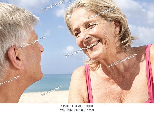 Spain, Mallorca, Senior couple sitting at beach