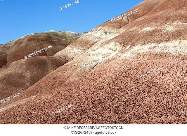 Red clay base alternates with other color bands of clay and volcanic ash in the Painted Hills in East Central Oregon
