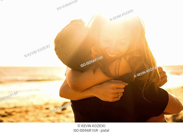 Couple having fun on beach, Malibu, California, USA