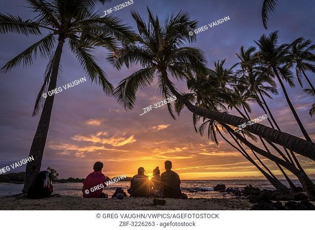Sunset and coconut palm trees at Makalawena Beach, Kekaha Kai State Park, Kona-Kohala Coast, Big Island of Hawaii