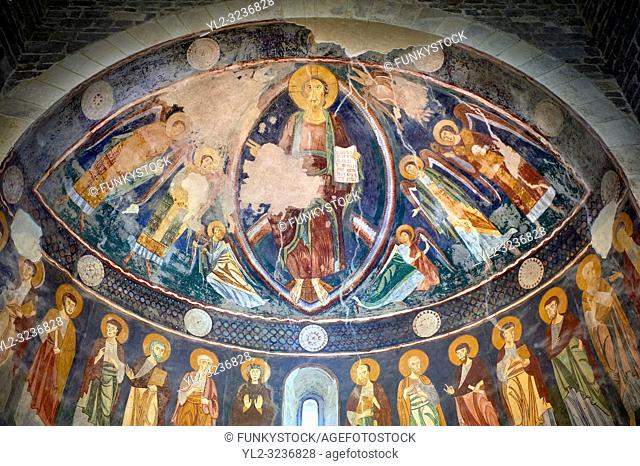 Interior Byzantine Romanesque style Christian frescoes of the central apse with Christ Pantocrator (in majesty) in a maodorla, Santissima Trinita di Saccargia