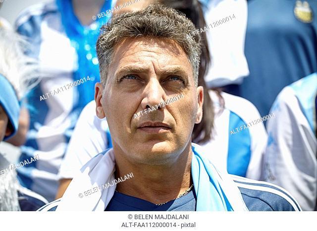 International football fan at match, portrait
