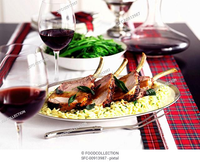 Pork cutlets on orzo, green beans and red wine