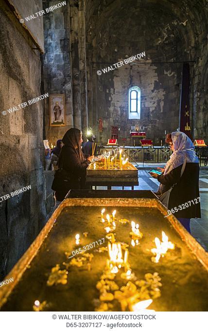 Armenia, Tatev, Tatev Monastery, 9th century, interior with visitors, NR
