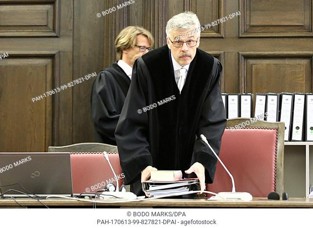 Judge Norbert Sakuth (c) arrives for the start of the trial against three suspected ISIS members in Hamburg, Germany, 13 June 2017