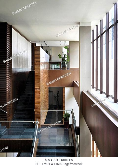 High angle view of landing and staircases in modern interior