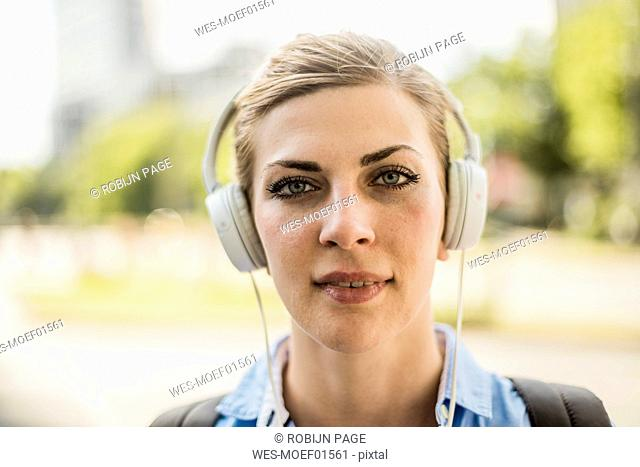 Portrait of confident woman wearing headphones