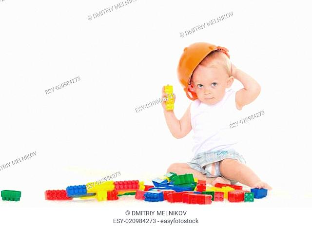 Sweet small baby with helmet and toys
