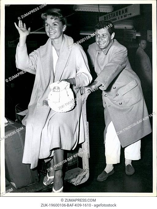 1967 - Idlewild Airport, N.Y., May 16 Pretty Debbie Reynolds gets an able assist from her singer husband Eddie Fisher with the baggage on their arrival from Los...