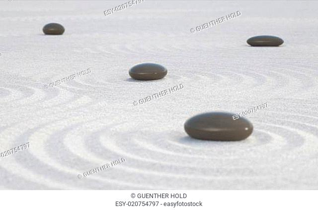Dark Zen stones on a wide sands