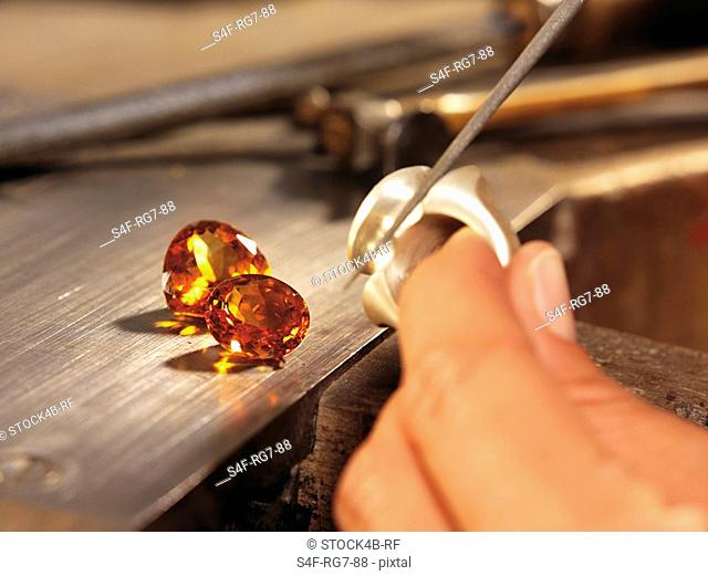 Jeweler working on ring in workshop, close-up