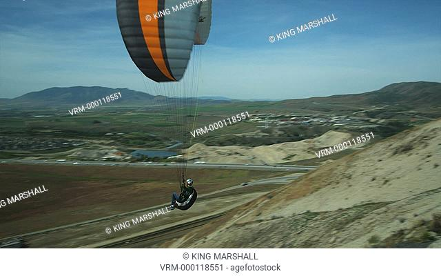 WS PAN POV Young man paragliding mid-air / Lehi, Utah, USA
