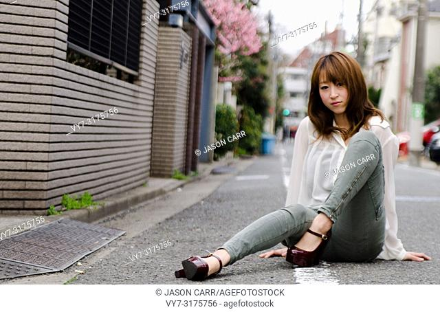 Japanese Girl poses on the street in Jiyugaoka, Japan. Jiyugaoka is a town located in Tokyo