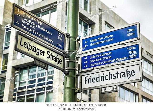 Multiple destinations signpost on the corner of Freidrichstrasse and Leipzig Strasse in Berlin, Germany
