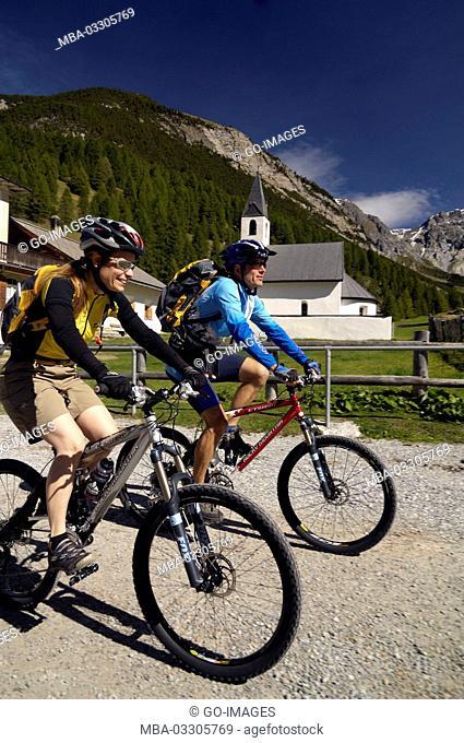 Mountain biker close S-Charl, Canton of Grisons, Switzerland