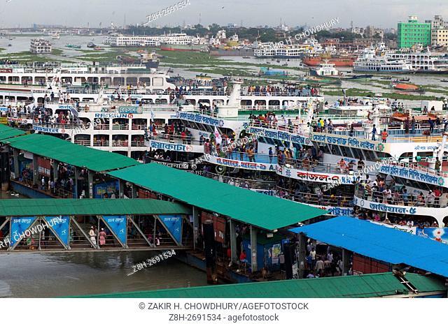 DHAKA, BANGLADESH - JULY 01 : Bangladeshi people travel home to their villages, ahead of the Eid Al-Fitr festival at Sadarghat Launch terminal in Dhaka