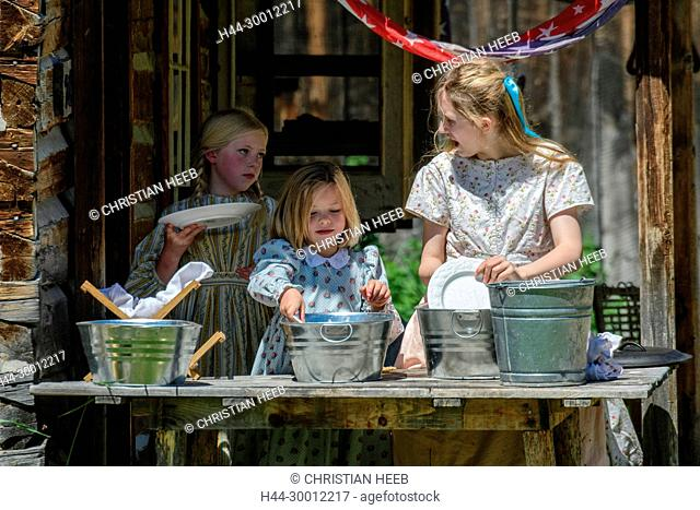 USA, America, Rockies, Montana, Nevada City Ghost Town , kids washing dishes in historic village