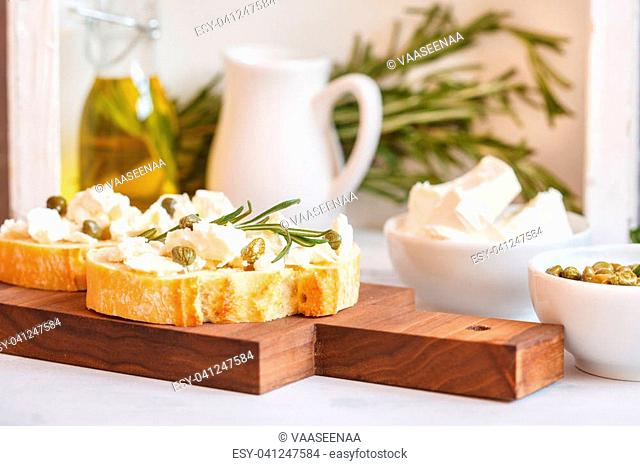 Fresh sandwiches with ciabatta and feta on a wooden board