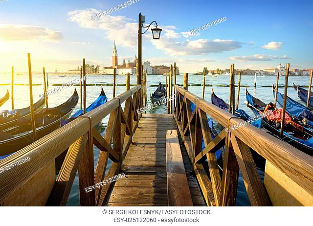 Condolas and wooden pier in Venice, Italy