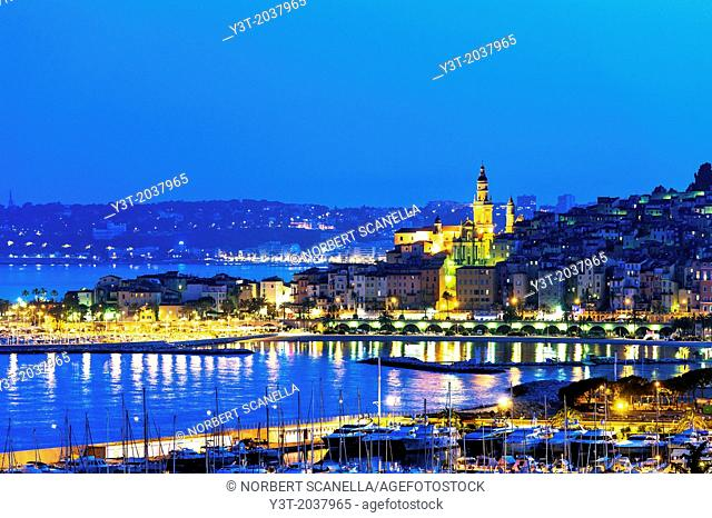 Europe, France, Alpes-Maritimes, Menton. Basilica Saint Michel and the marina at night