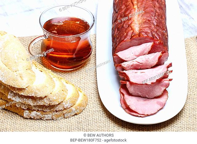 Sliced sausage on wooden table