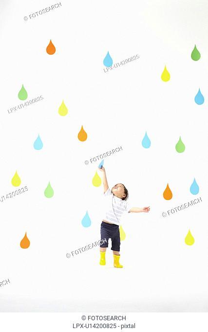 Boy Catching Raindrop