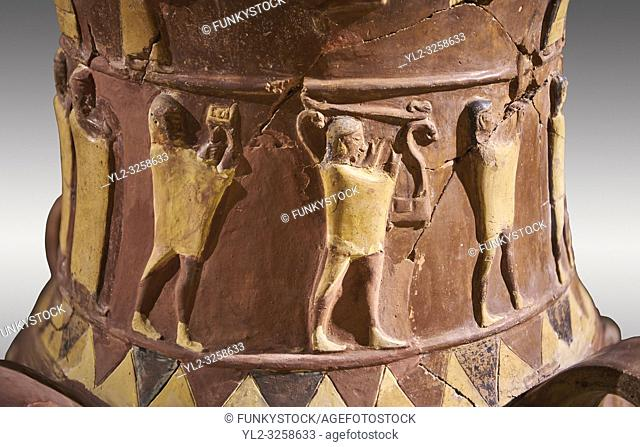Close up of the Inandik Hittite relief decorated cult libation vase decorated with relif figures coloured in cream, red and black