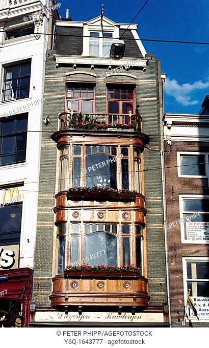 House with wooden bay windows Amsterdam