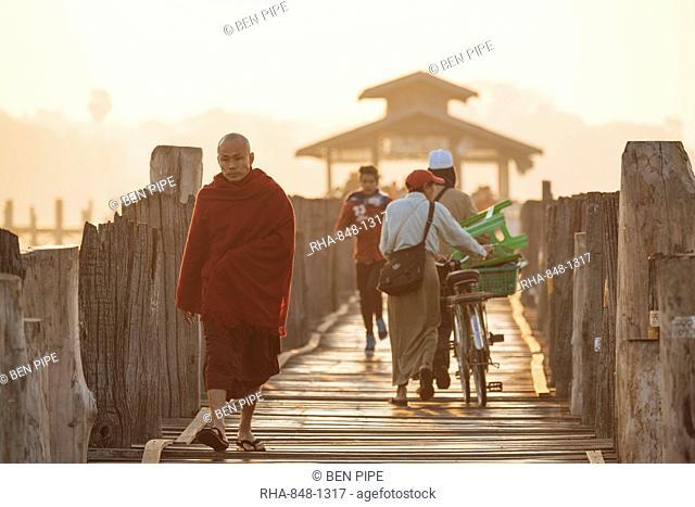 Early morning pedestrian traffic on U-Bein Bridge, Amarapura, Mandalay, Mandalay Region, Myanmar (Burma), Asia